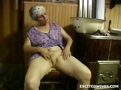 Old Lady Uses Huge Dildo On Herself