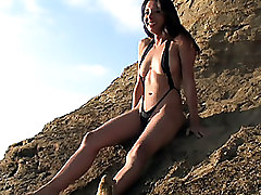 Araceli In A One Piece Sling Shot Micro Thong Camel Toe