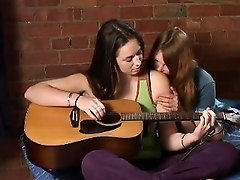 Lesbian Guitarplayer Kissing