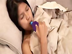 Petite Asian Sucking Lolly On The Bed