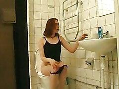 Amateur Redhead Bitch Slurps On Huge Shaft In The Toliet