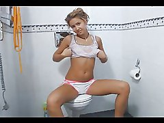Cute Blonde Teenie Teasing Naked On A Toilet