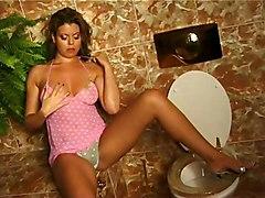Woman Rubs On Toilet 1
