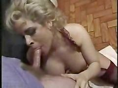 Mature Woman In Lingerie Sucking Cock.