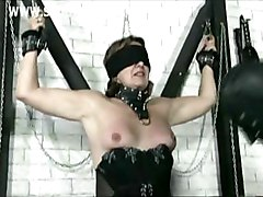 Beautiful Older Slave Tied To A Wall With Nice Tits Got Clampes With Heavy Weights On Her Pussy