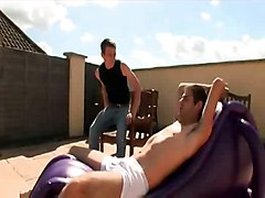 Two Lads Work On Their Tan