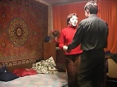 The Russian Woman And Young Person On Secret To Apartment