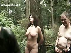 Horny Slave Teid To A Tree Got Clamps On Her Beautiful Tits By Two Masters While Husband Is Watching