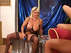 Granny Takes Turns With Busty Brunette To Get Fucked