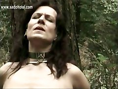 Slave Tied To A Tree Is Hit With A Whip And Master Mastrubates Her Pussy While Her Husband Is Watching