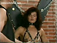Horny Slave With Large Metal Clamps On Her Pussy Lips And Tied To Wall Is Spanked By Master
