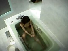 Japanese Girl Rubs Her Clit In Bathtub